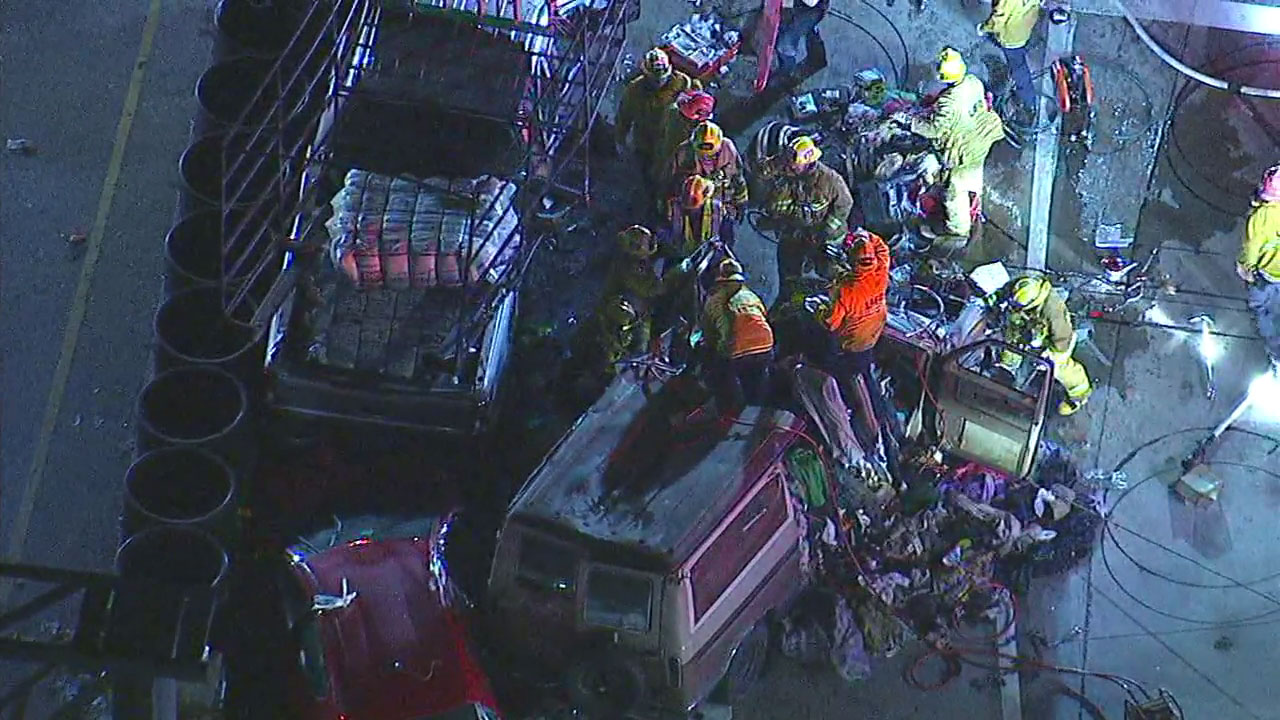 Authorities are shown removing items stuffed into a van to rescue the driver following a multi-vehicle crash in Sherman Oaks.