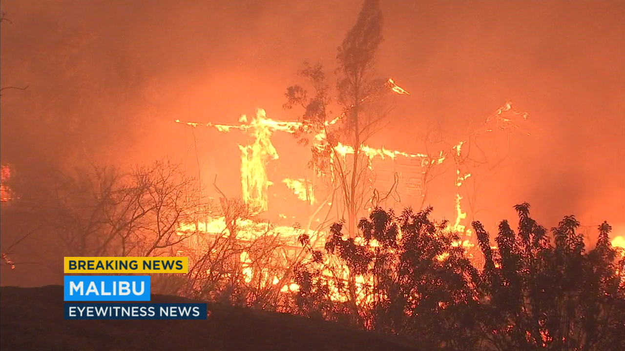 A home burns in Malibu after flames from the Woolsey Fire consumed it.