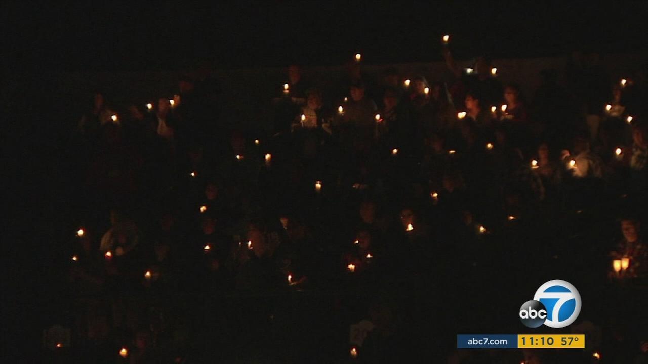 Thousands gathered at San Manuel Stadium in San Bernardino following Wednesdays mass shooting that killed 14 people and injured 21.