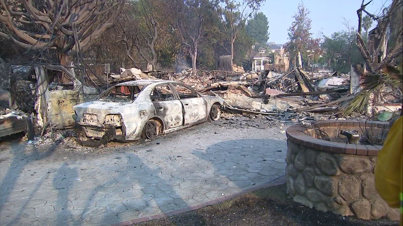 A charred vehicle is parked where a home used to be in the Bell Canyon area on Saturday, Nov. 10, 2018.