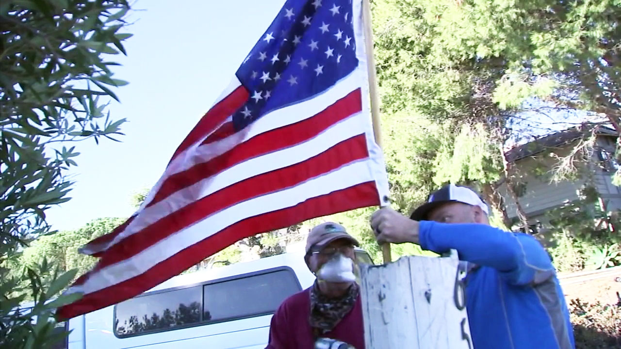 On a street with more than a dozen homes burned by the Woolsey Fire, a group of Malibu residents still made sure to put up the American flag to honor veterans.