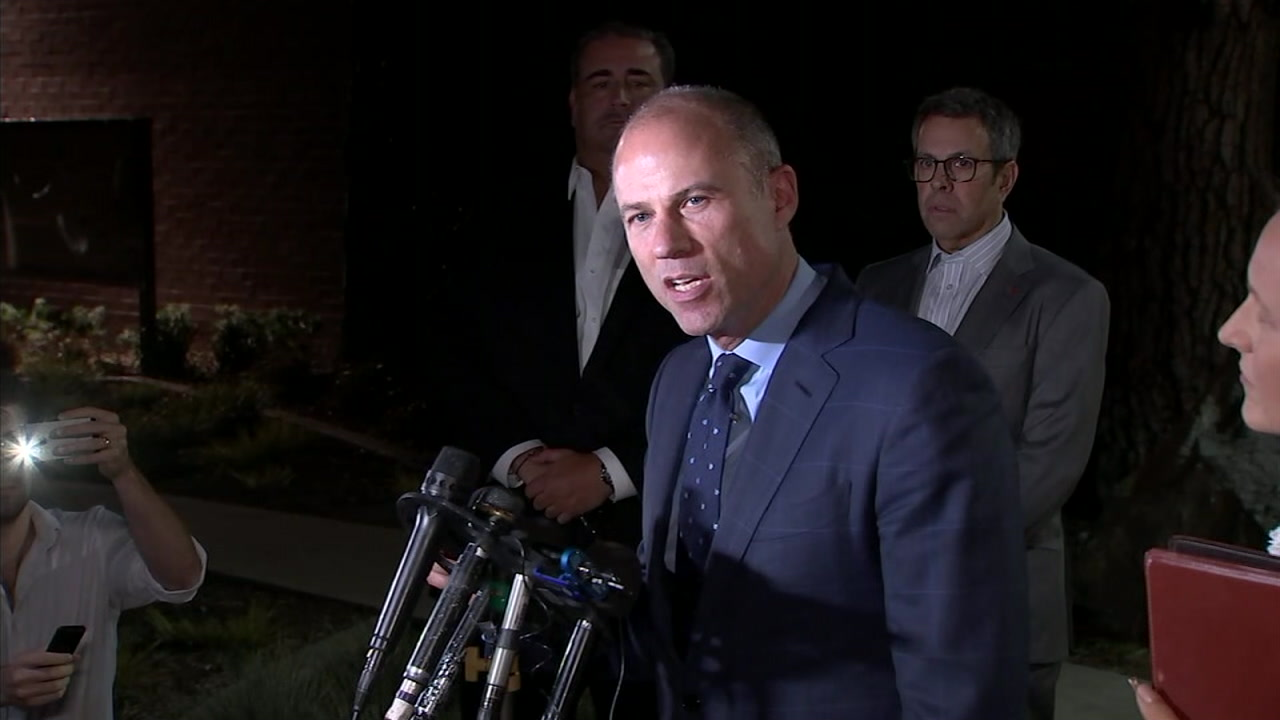Michael Avenatti speaks to reporters after being arrested on suspicion of domestic violence in Los Angeles.