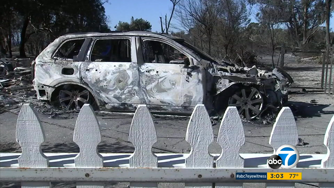 The shell of a car burned by the Woolsey Fire in Malibu.