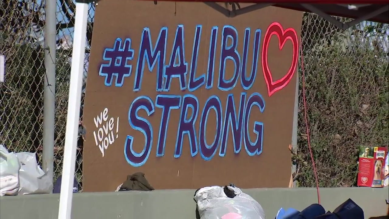 A sign reads #MalibuStrong after the Woolsey Fire destroyed homes in the area.