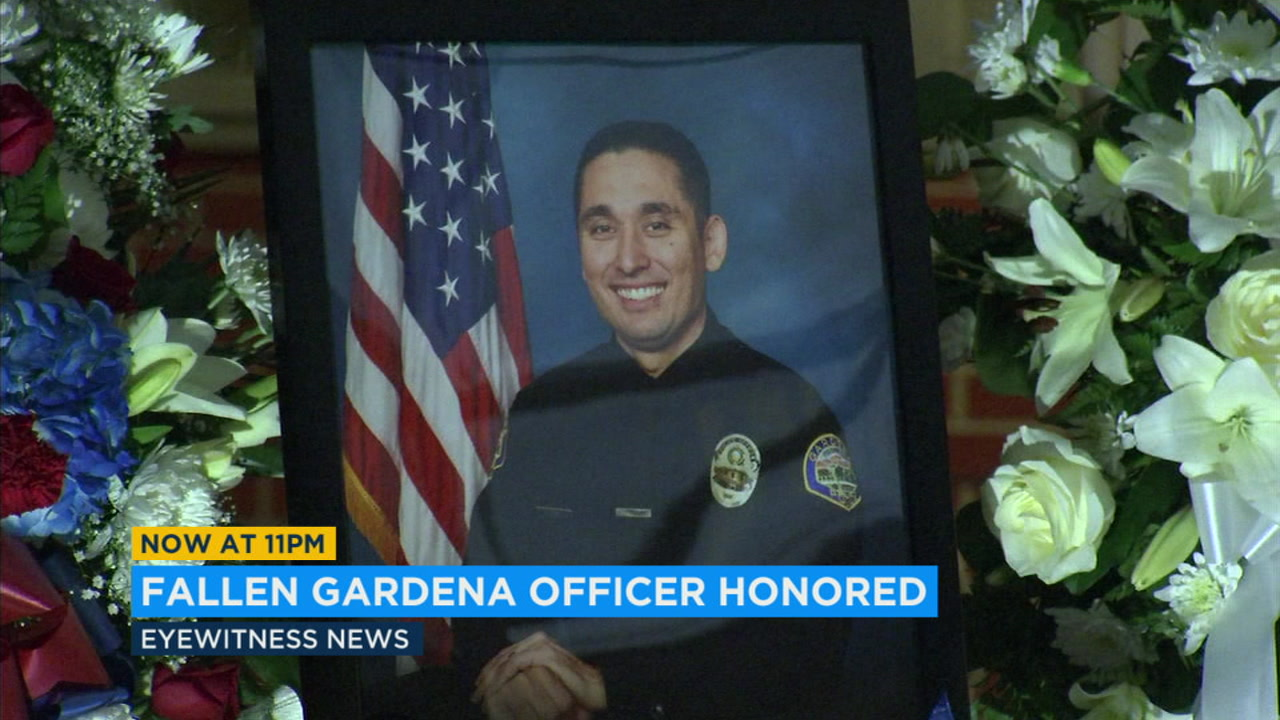 A photo of Gardena Officer Toshio Hirai is displayed at his vigil, held Friday Nov. 17, 2018.