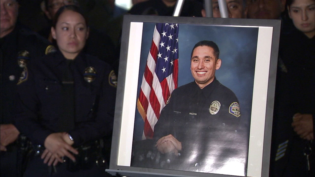 Members of the Gardena Police Department gather to honor Officer Toshio Hirai, who was killed in a crash while on his way to work.