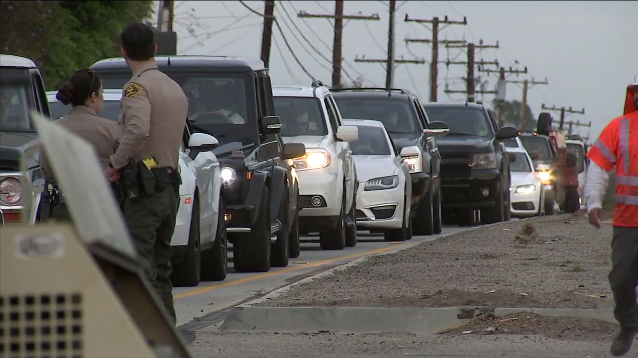 Residents back up traffic as some evacuations lift in the Woolsey Fire burn areas.