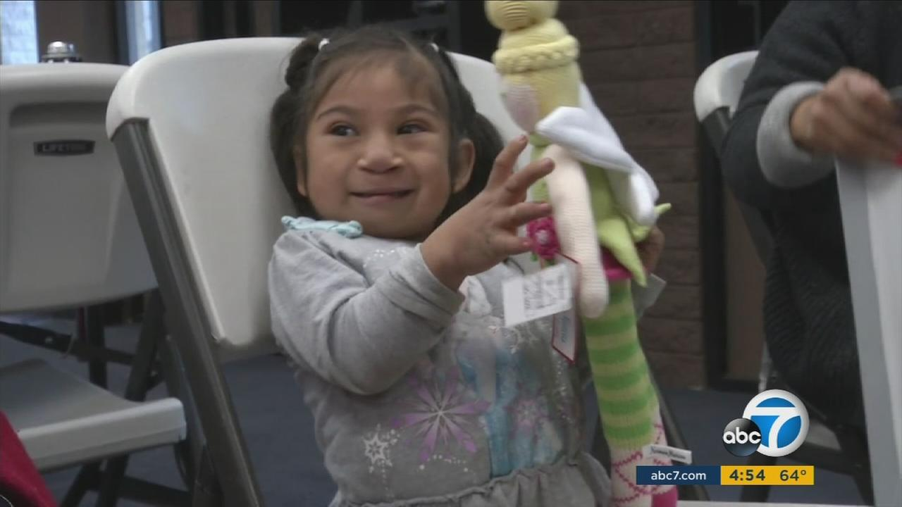 Milagros Perez, the 4-year-old girls whose special wheel chair was stolen then returned, plays with early Christmas gifts thanks to donations from the community.