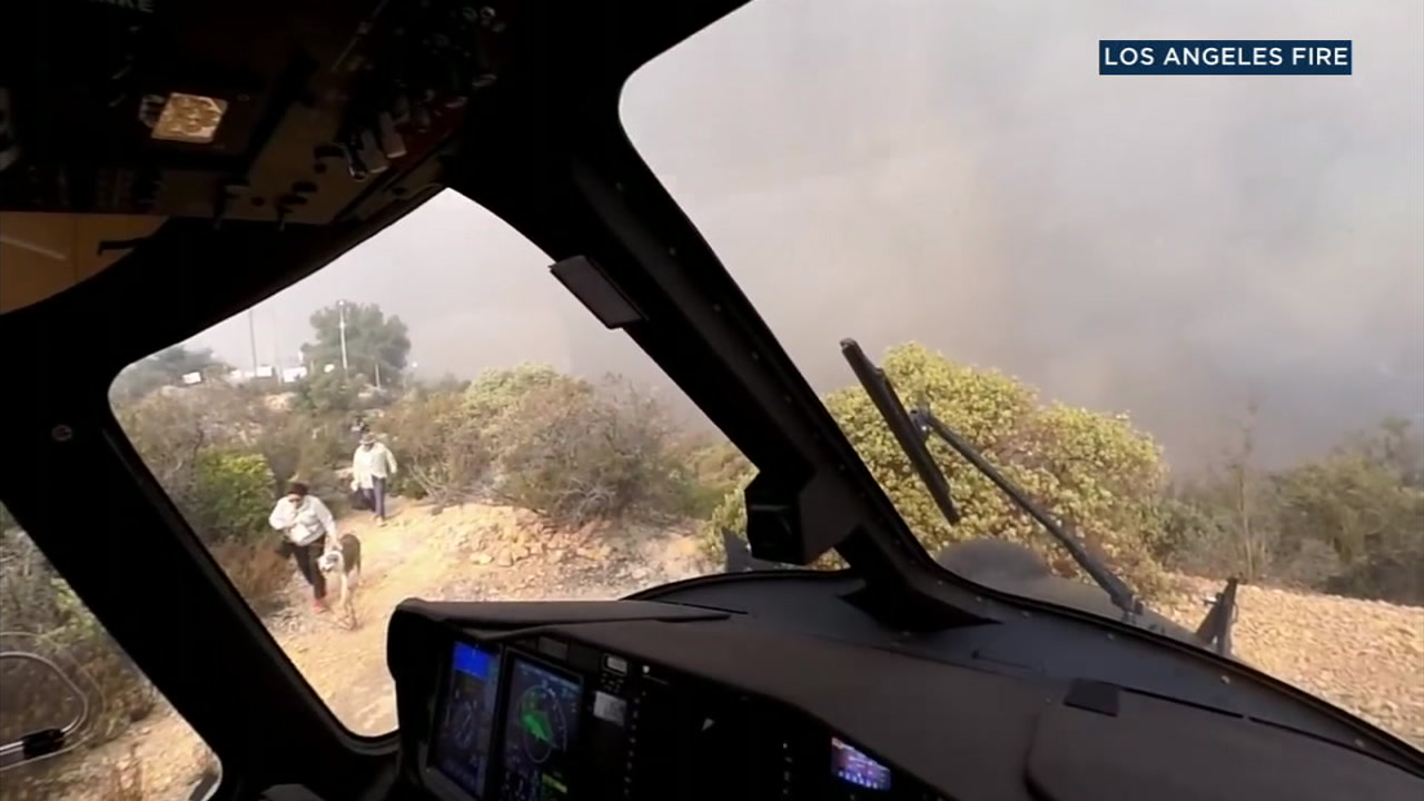 Three people and two dogs were rescued during the height of the Woolsey Fire by LAFD helicopter pilots.