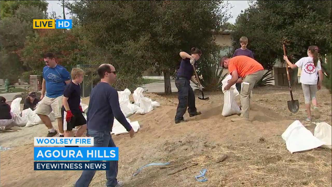 Volunteers fill sandbags at a fire station in Agoura Hills on Monday, Nov. 19, 2018.
