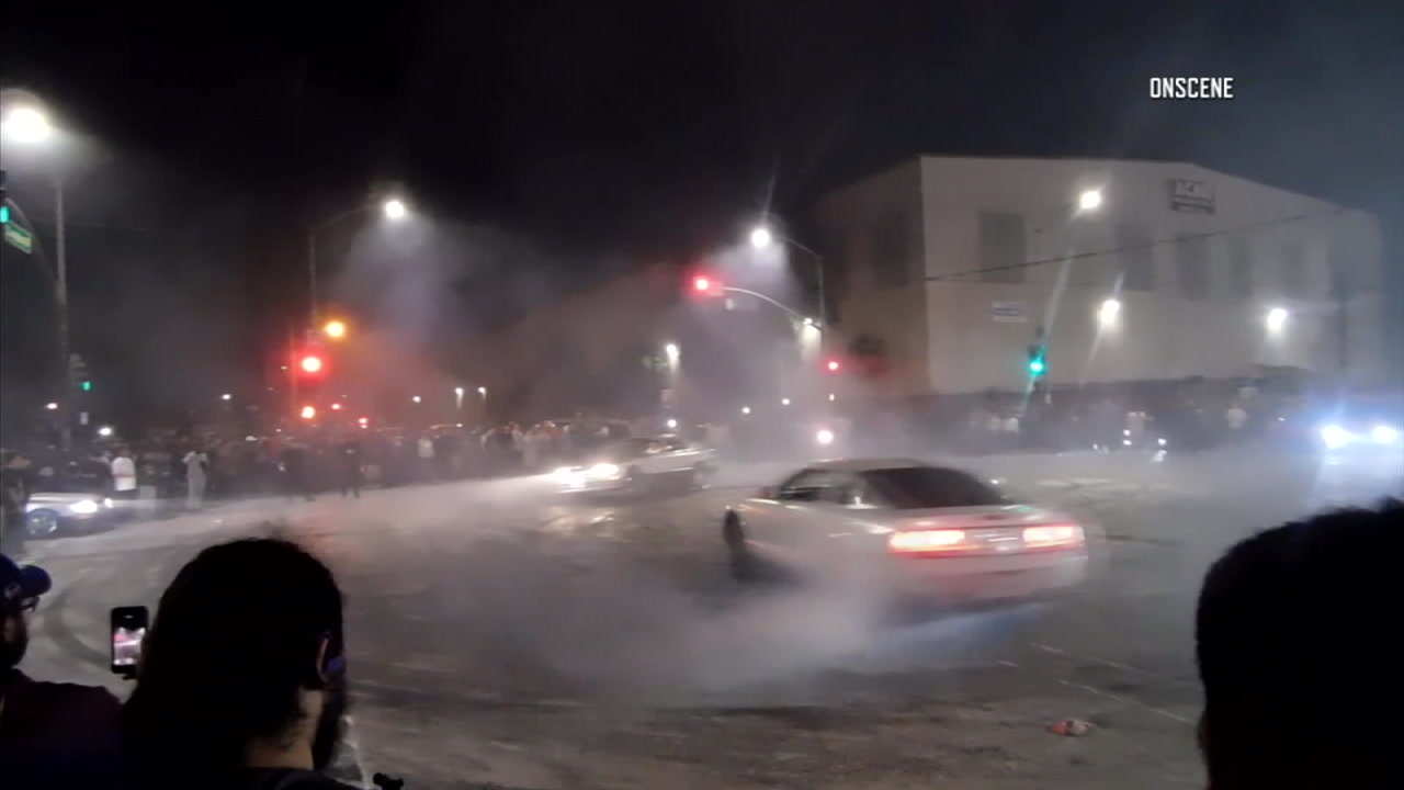 An image from news video shows a street takeover in Southern California.