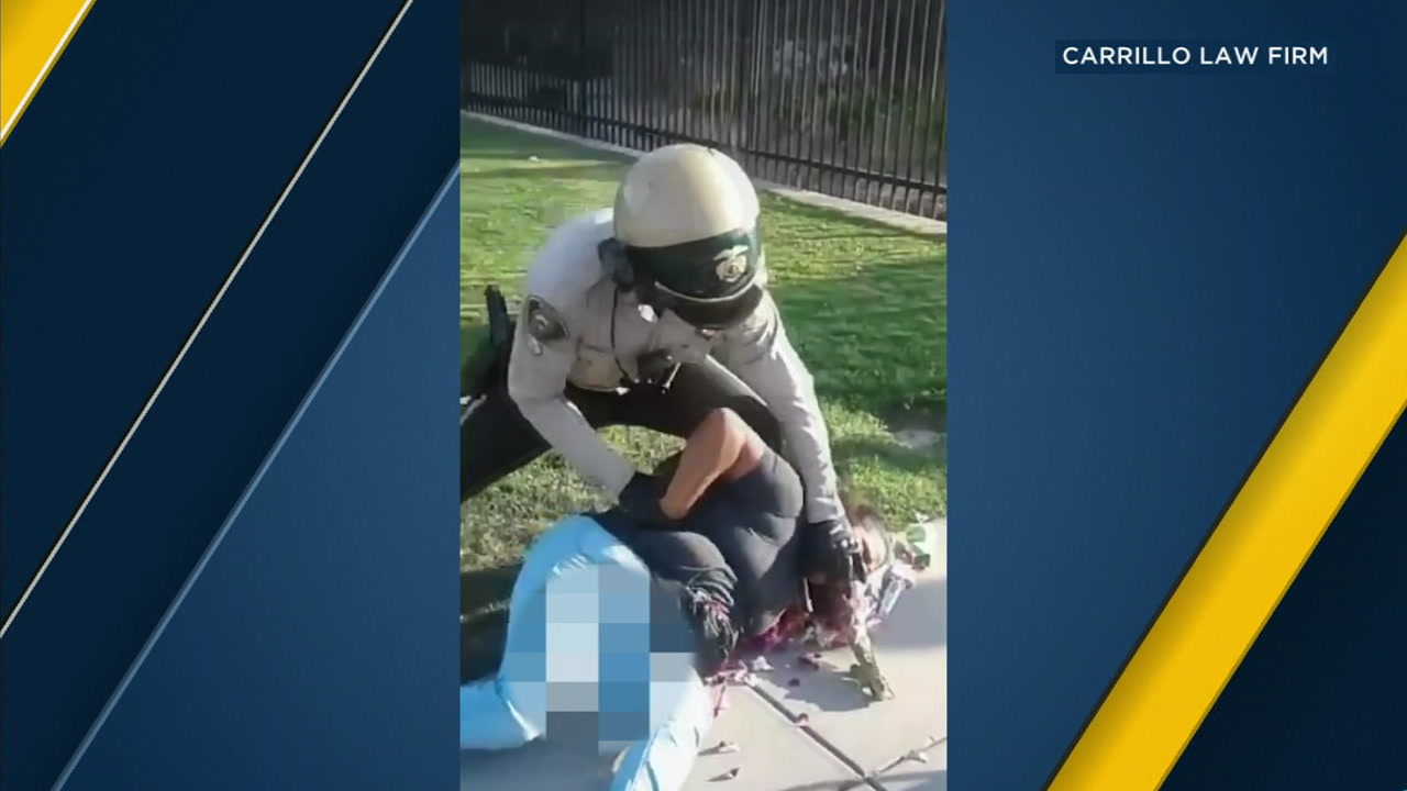 Joaquina Valencia is seen on the ground as a Riverside County Sheriffs officer attempted to arrest her.