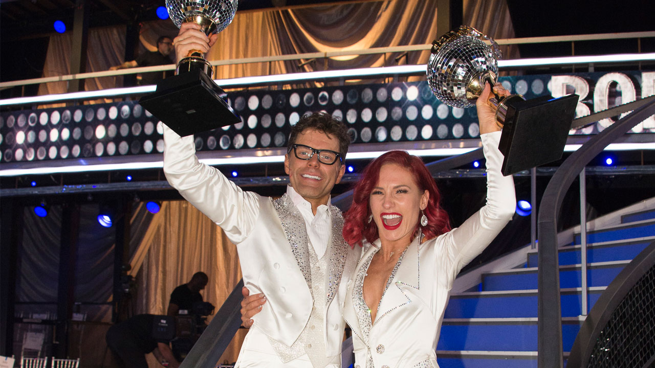 A photo shows DWTS Season 27 finale winners Bobby and Sharna.