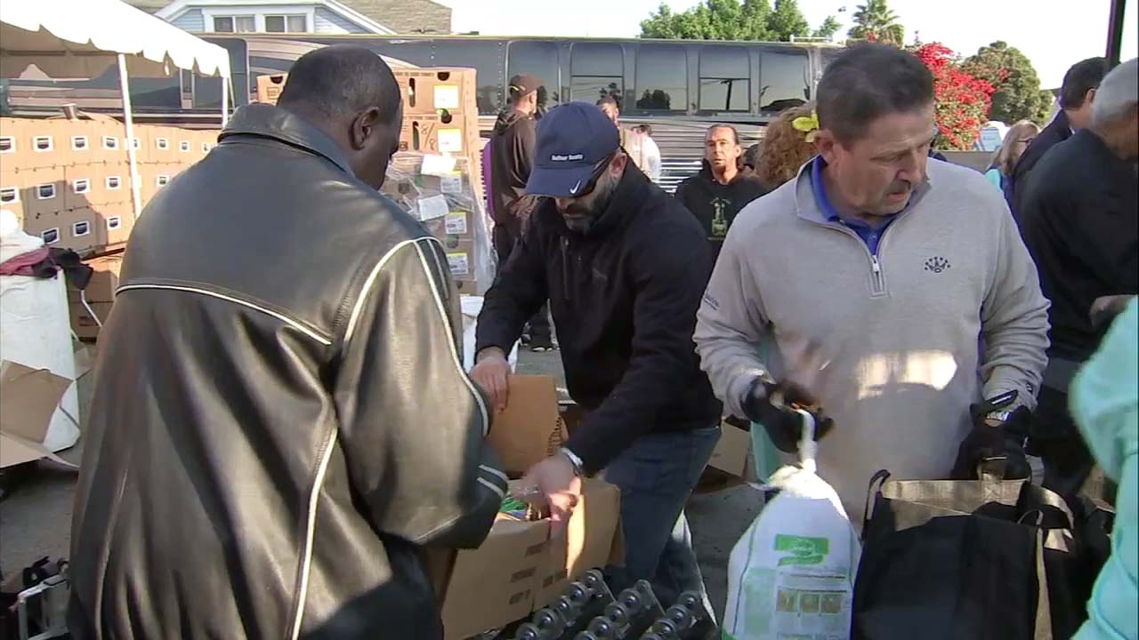 Volunteers give away Thanksgiving meals in South Los Angeles as part of an annual event.