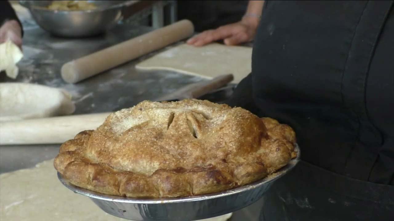 Chef Clemence Gossett holds a finished pie.