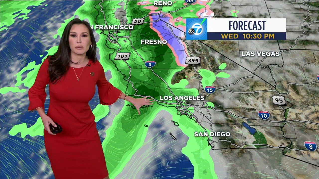 Leslie Lopez uses a graphic to show where the rain will be around 10:30 p.m. Wednesday.