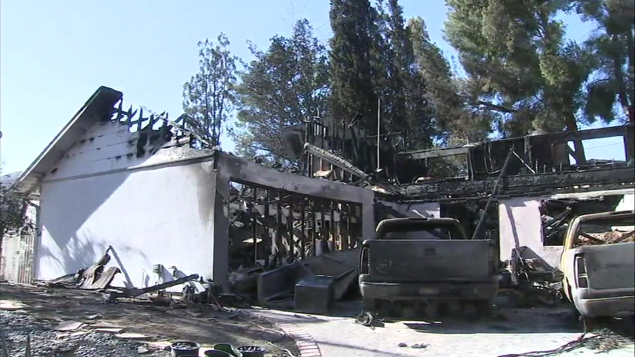A home and a pair of vehicles in Calabasas are turned into rubble from the destructive Woolsey Fire.