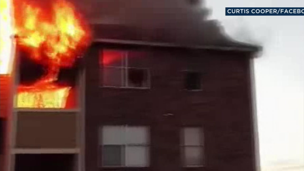 Residents of a burning Dallas apartment complex leap from third-floor windows onto mattresses.