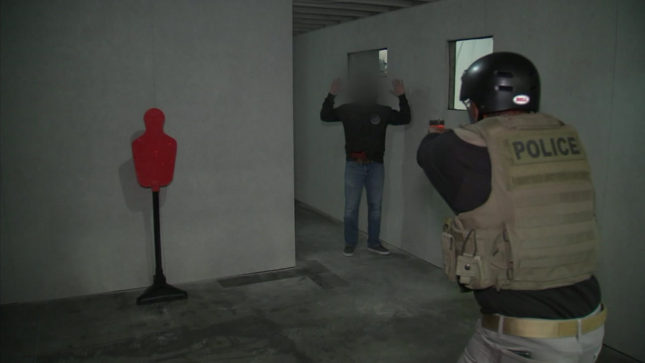 ABC7 anchor Marc Brown is shown during a DEA agent training session at a new facility where they practice serving search warrants.