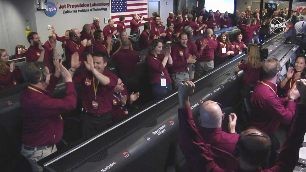 NASA scientists celebrate after the InSight spacecraft touches down on Mars on Monday, Nov. 26, 2018.