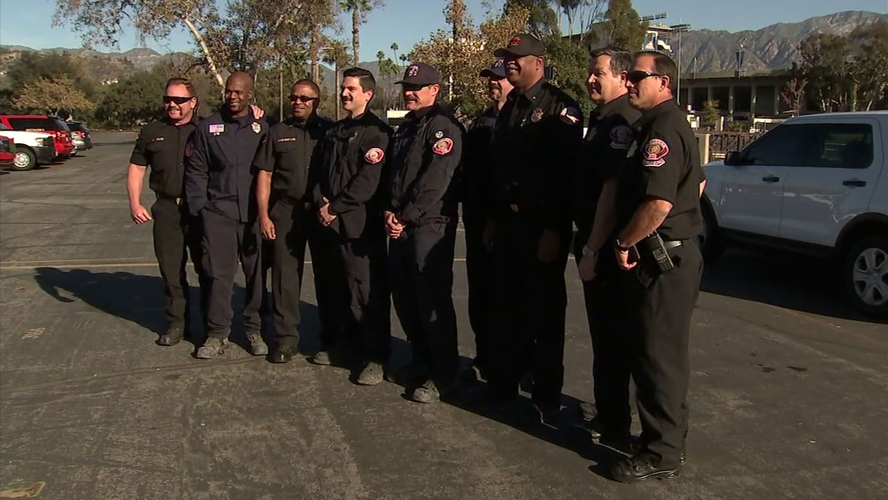 Firefighters from Pasadena, Monrovia and Arcadia pose for a photo after coming back from doing search-and-recovery efforts in Northern California.