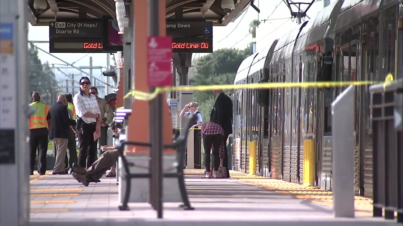 Law enforcement officials investigate a fatal stabbing at a train station in Duarte on Tuesday, Nov. 27, 2018.