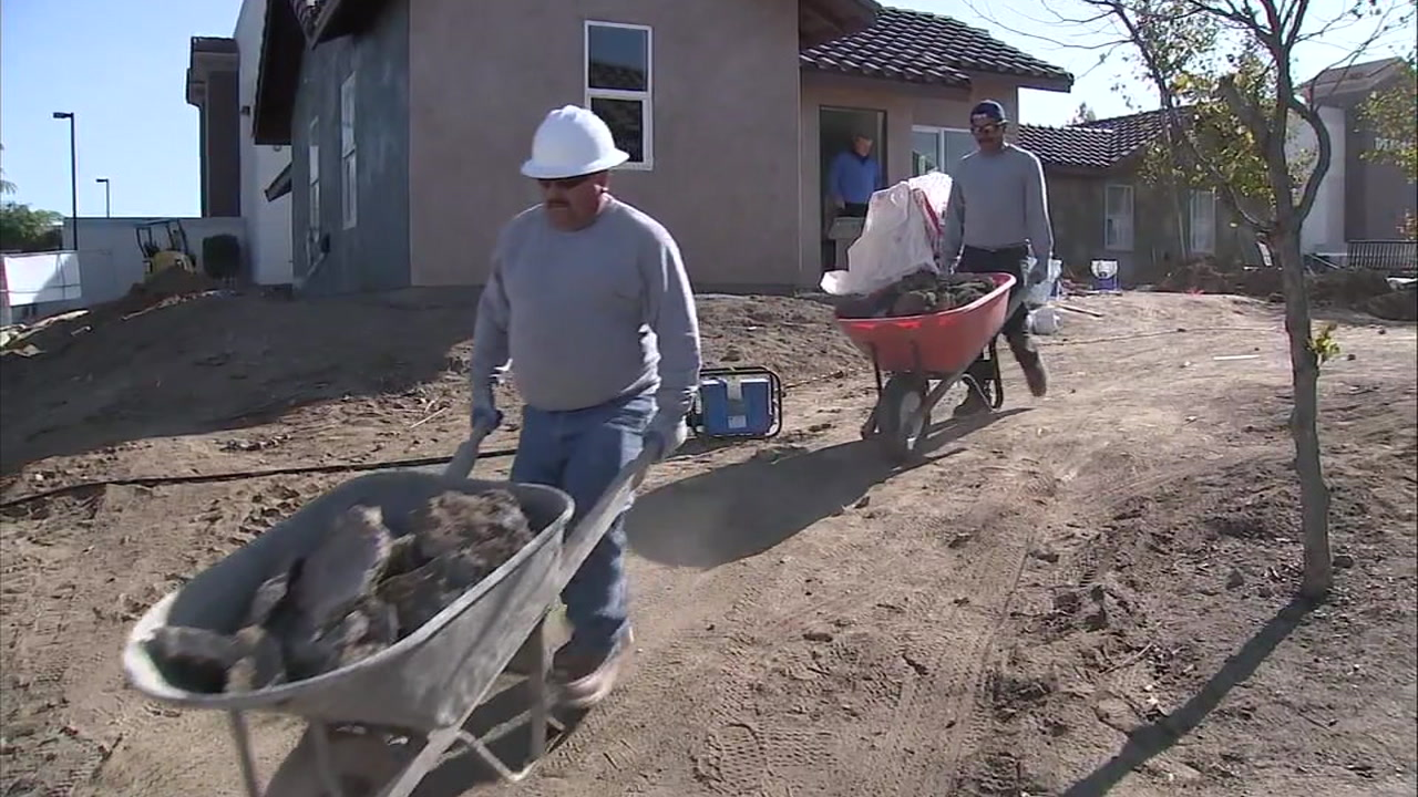 Workers are putting the finishing touches on four homes for the homeless at Riversides Grove Community Church.