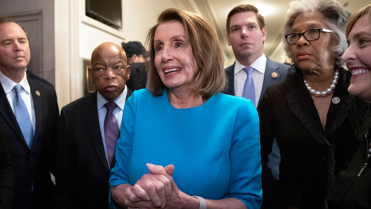 House Democratic Leader Nancy Pelosi emerges victorious from the Democratic Caucus leadership elections at the Capitol in Washington, Wednesday, Nov. 28, 2018.