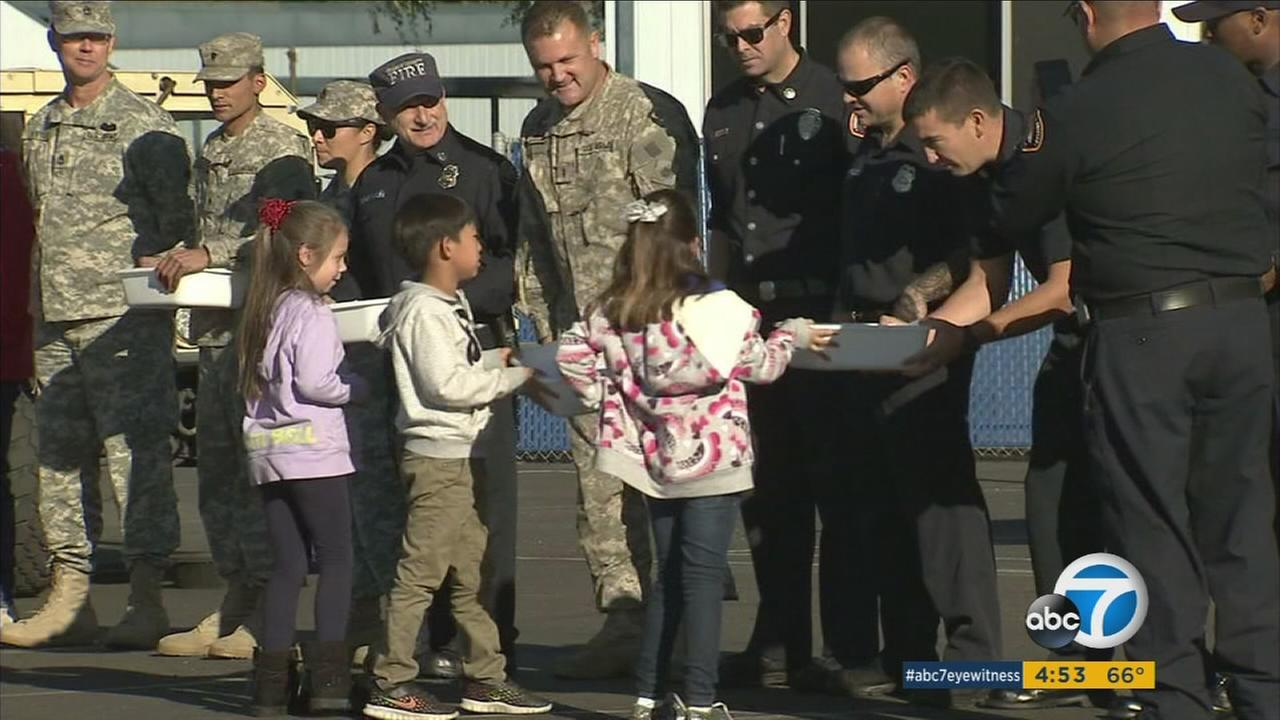 Rossmoor Elementary School students give law enforcement care packages to send to troops from Los Alamitos.