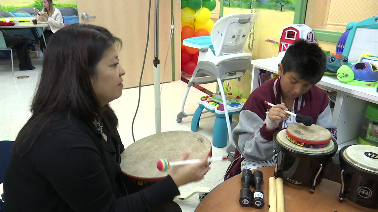 Eleven-year-old Bryan Huerta of Montebello is joining in a music therapy session with Jana Skrien Koppula, a music therapy coordinator.