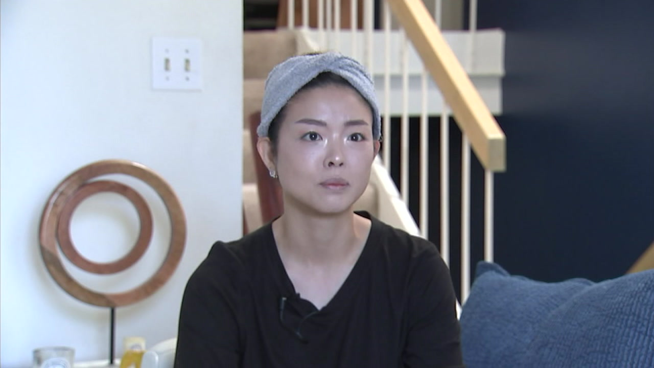 Carol Um is shown in a photo during an interview with ABC7.