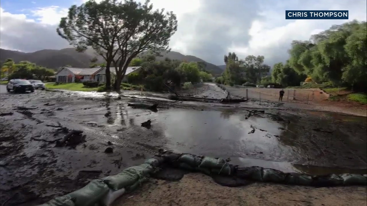 Mud-covered roads are shown in Lake Elsinore the morning after rains brought mud down into a neighborhood.