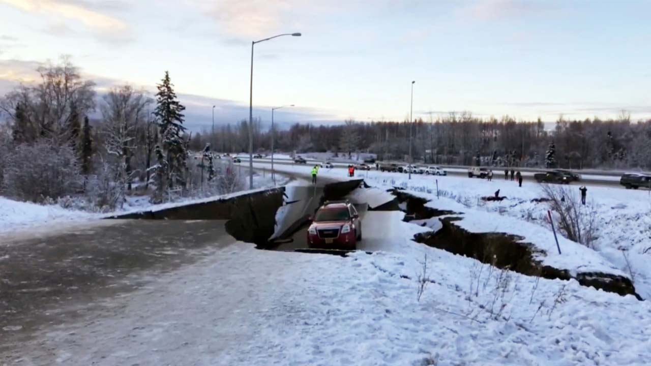 A car is trapped on a collapsed section of the offramp in Anchorage, Friday, Nov. 30, 2018.