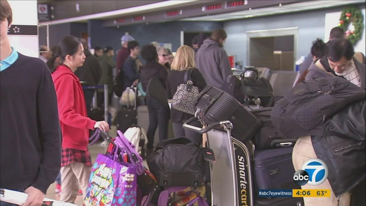 Travelers waiting in long lines at LAX during the second-busiest day of the year on Wednesday, Dec. 23, 2015.
