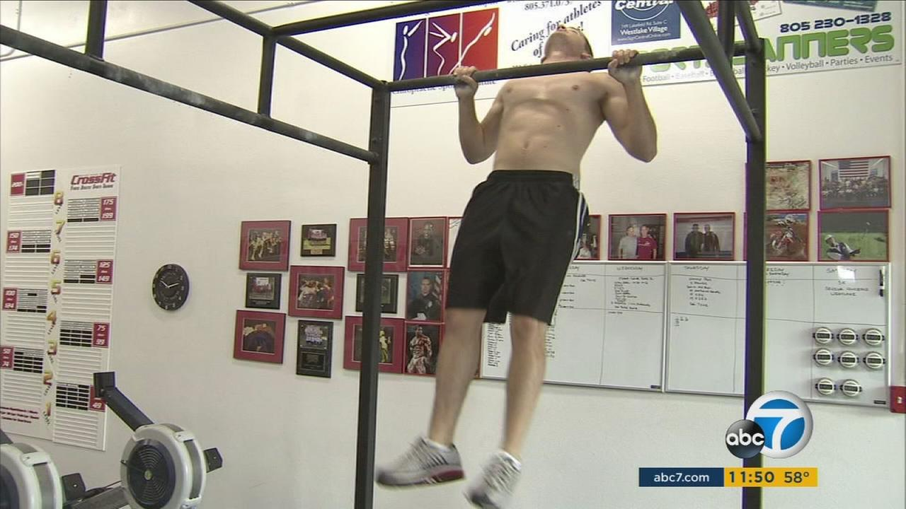 A man does a pull up on a bar in this undated file photo.