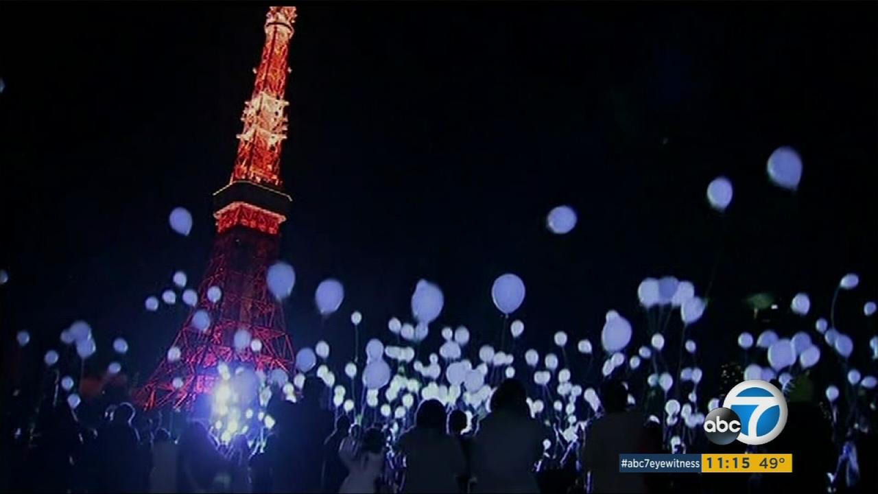Revelers gather to release 1,000 balloons into the night sky in Tokyo on New Years Eve, Dec. 31, 2015.