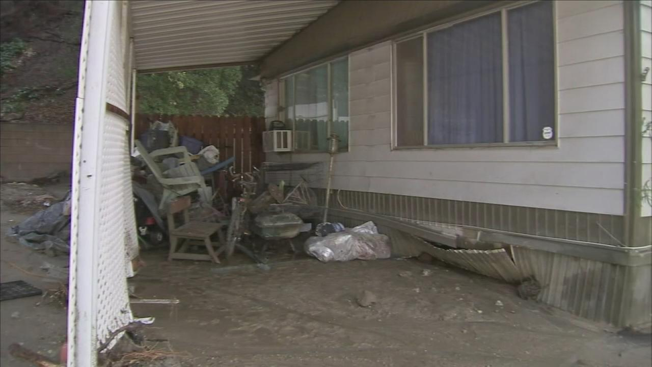 Cleanup is underway in the Newhall area, where heavy rain sent mud and debris flowing down the hillside, into streets and up against mobile homes.