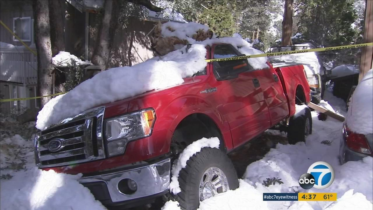 Mountain communities suffered damage to houses and vehicles after El Nino-fueled storms swept through the area.