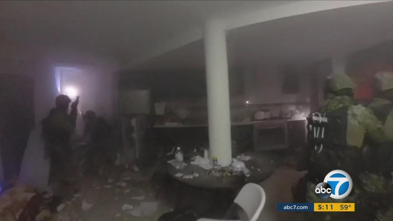 Video released by Mexican authorities shows officials raiding a home in an attempt to recapture drug lord Joaquin El Chapo Guzman in Los Mochis, Mexico, on Friday, Jan. 8, 2016.