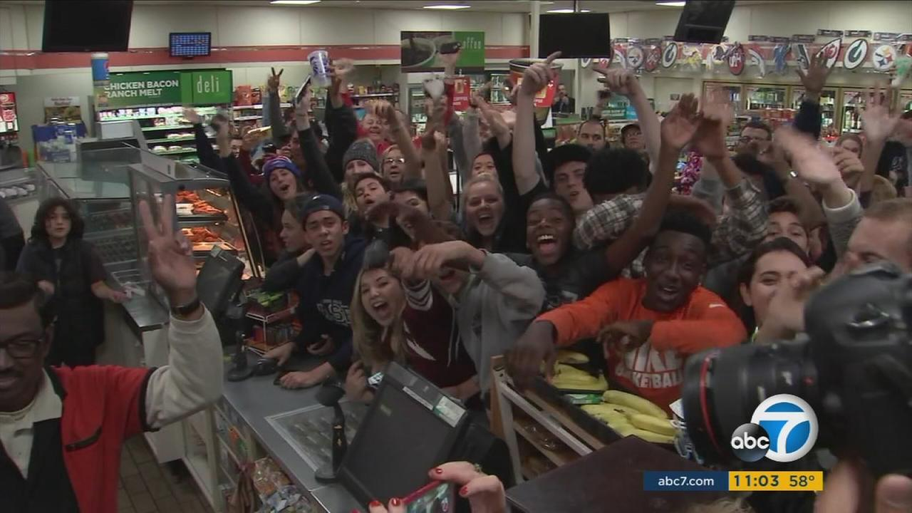 People celebrate in the Chino Hills 7-Eleven that a winning ticket for the $1.5 billion Powerball jackpot on Wednesday, Jan. 13, 2016.