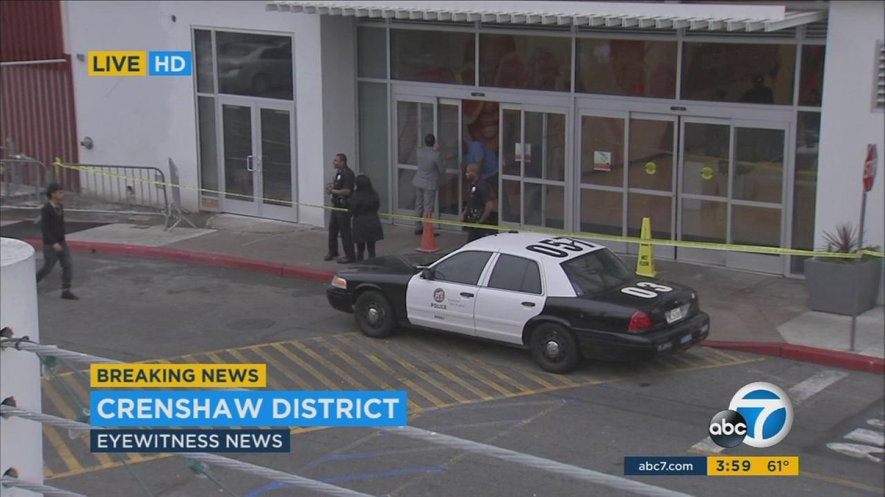 Police investigate a shooting at the Baldwin Hills Crenshaw mall on Monday, Jan. 18, 2016.