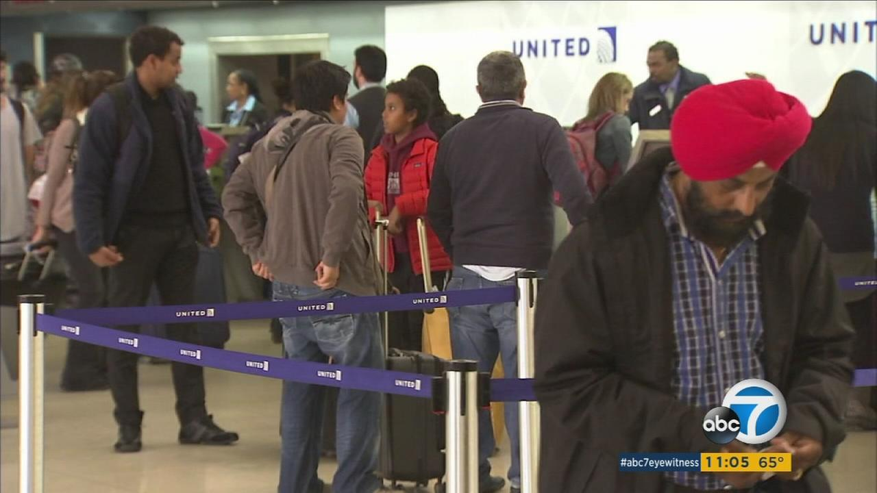 File photo of travelers at Los Angeles International Airport.