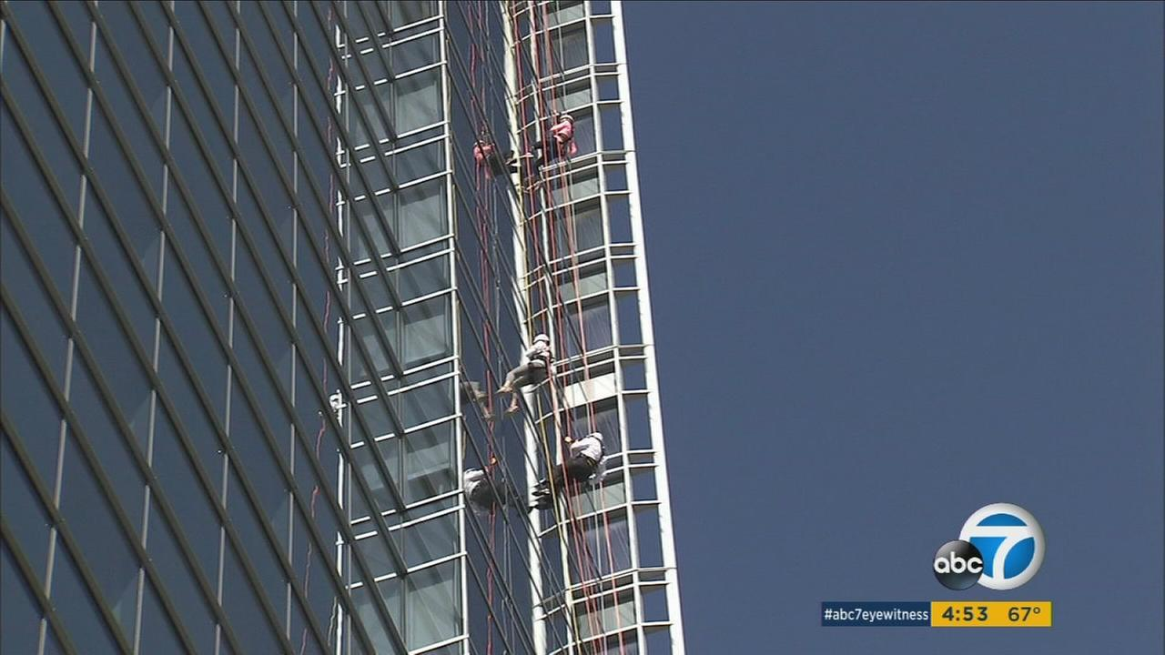 Hotel executives and employees rappel down a downtown LA high-rise for addiction awareness on Monday, Jan. 26, 2016.