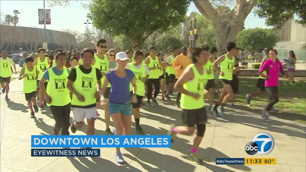 Runners practice before the Los Angeles Marathon.