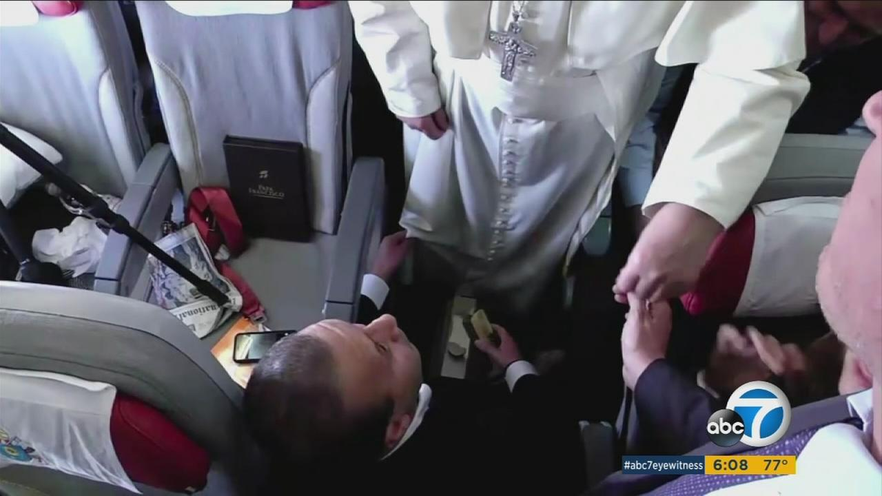 Noel Diaz of Northridge shines the shoes of Pope Francis during the pontiffs historic trip to Mexico.