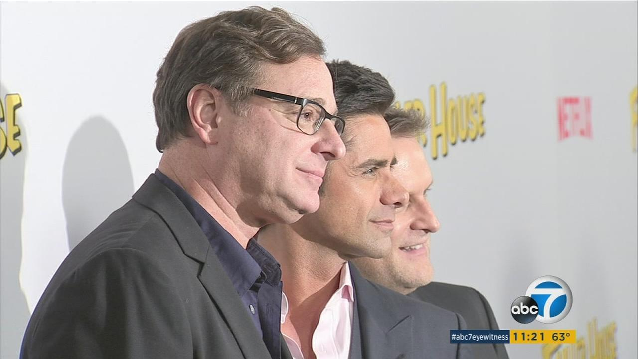 Bob Saget (left), John Stamos (center) and Dave Coulier (right) pose for a picture before the premiere of Fuller House in Los Angeles on Tuesday, Feb. 16, 2016.