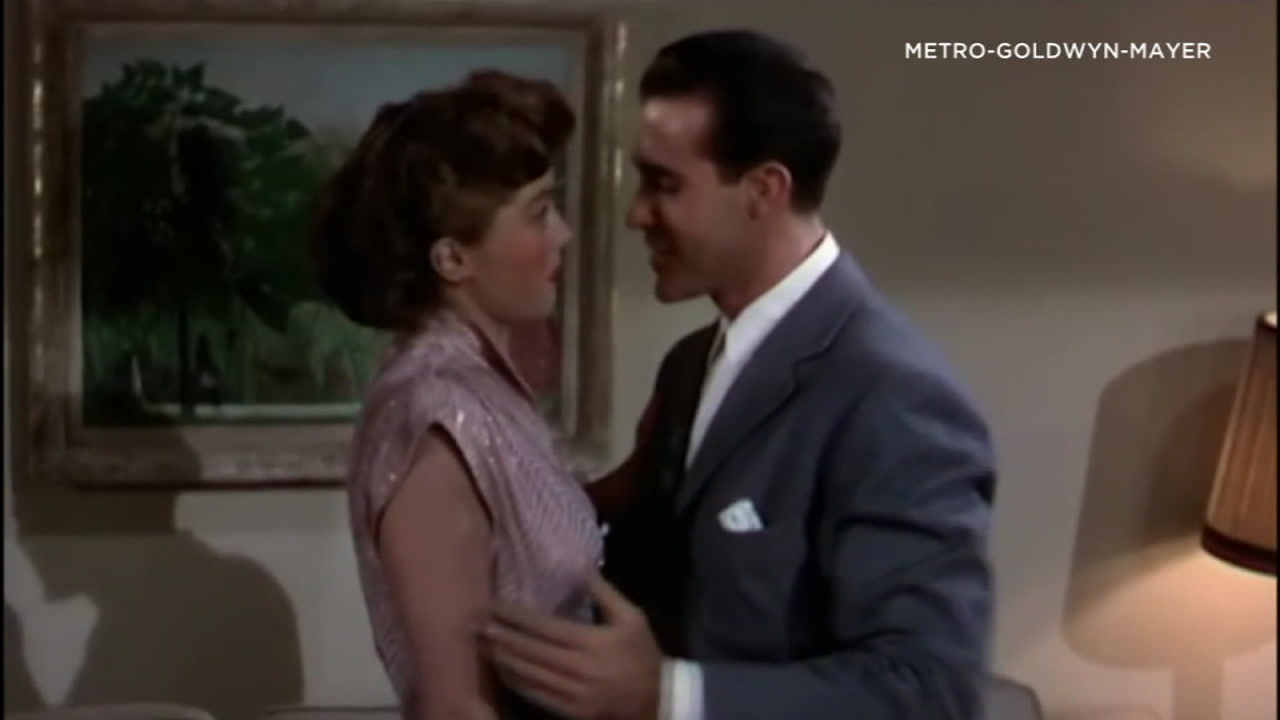 The actors who sang Baby Its Cold Outside first are shown in a clip from a movie.
