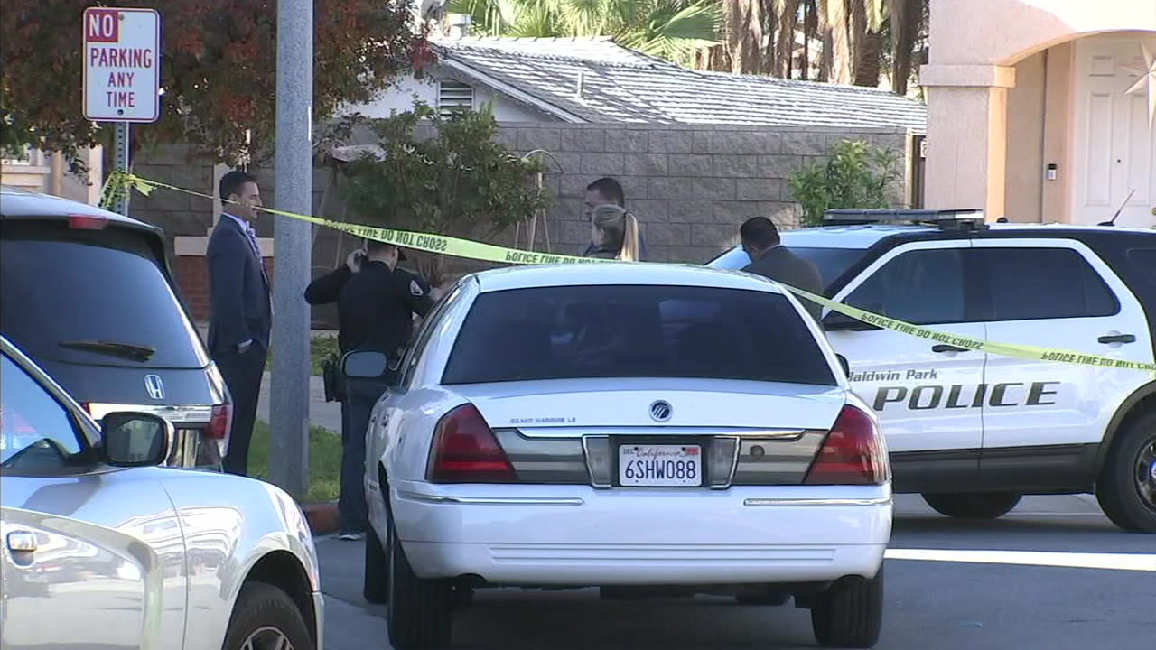 Authorities surrounded a home in Baldwin Park, where a mother and her son were found dead.