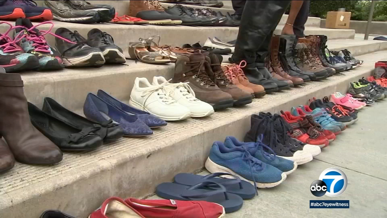 The stairs of Santa Monica Catholic Church were lined with 96 pairs of shoes to honor the Thousand Oaks shooting victims and to signify the number of people killed by guns daily.
