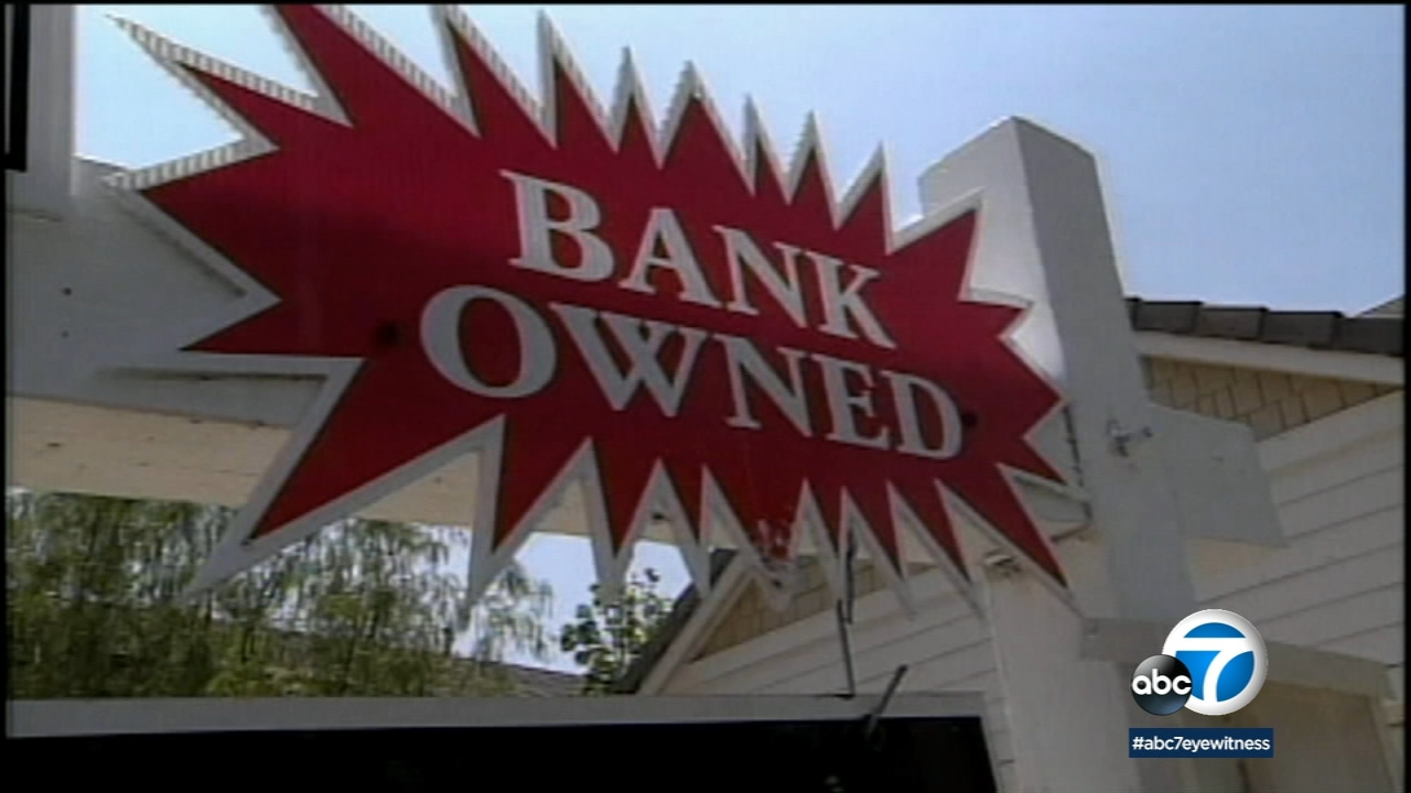 A bank owned sign on a foreclosed home is shown in a file photo.